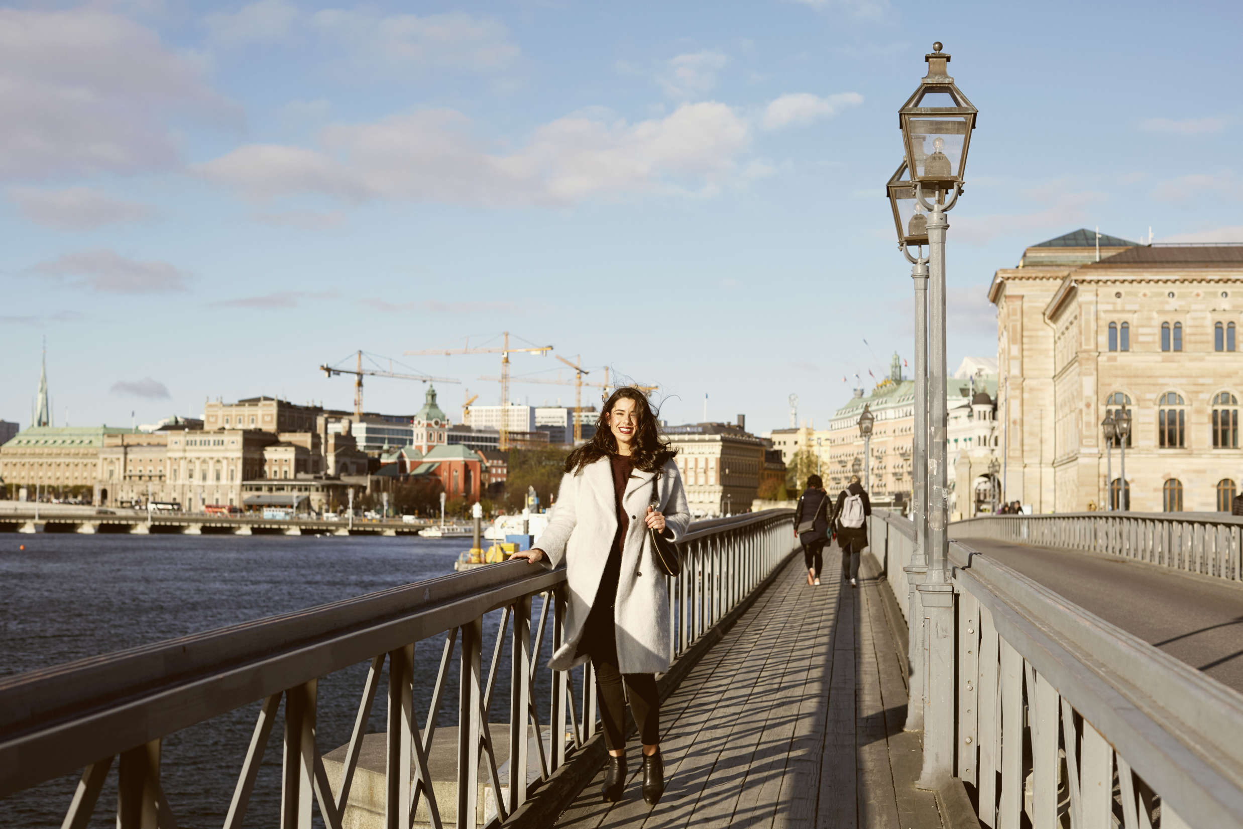 Woman on Bridge in Stockholm: 6 Points to remember when moving your new hire to Sweden