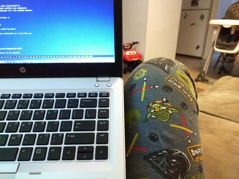 computer in lap of person wearing pajamas: Working from home in pajamas requires perfect English