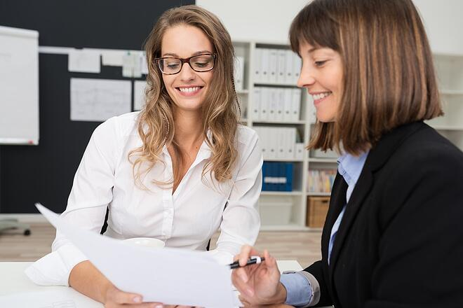 Close up Two Happy Young Businesswomen: Why it is harder for HR to manage expats in Sweden