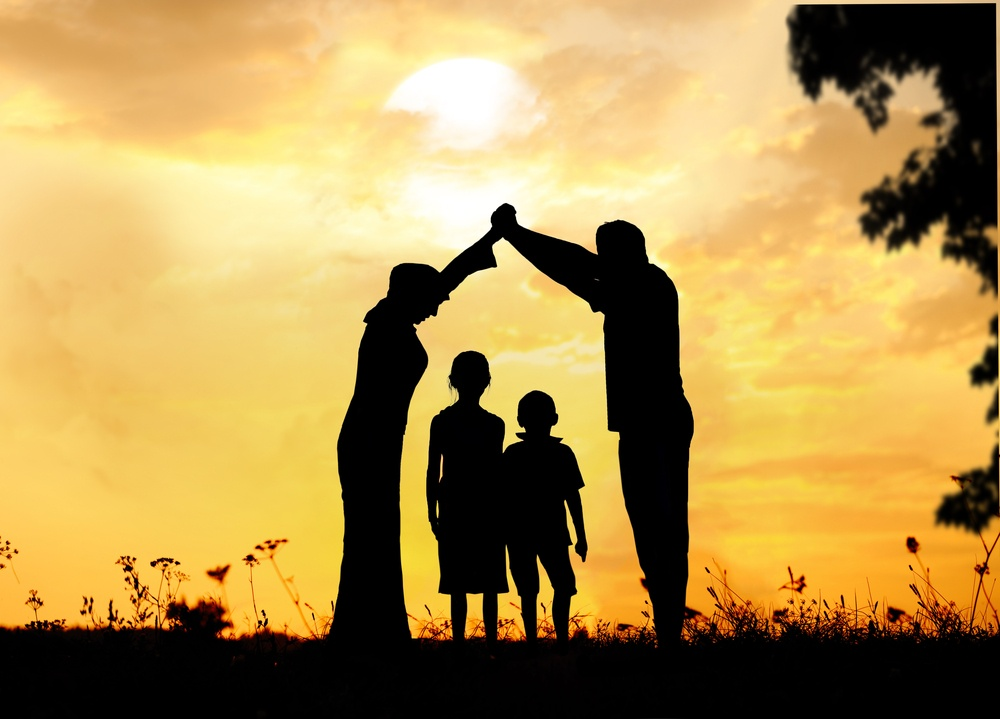 Shadows of Happy parents with kids at sunset: WHAT DOES THE TERM FAMILY MEAN TO THE SWEDISH MIGRATION AGENCY