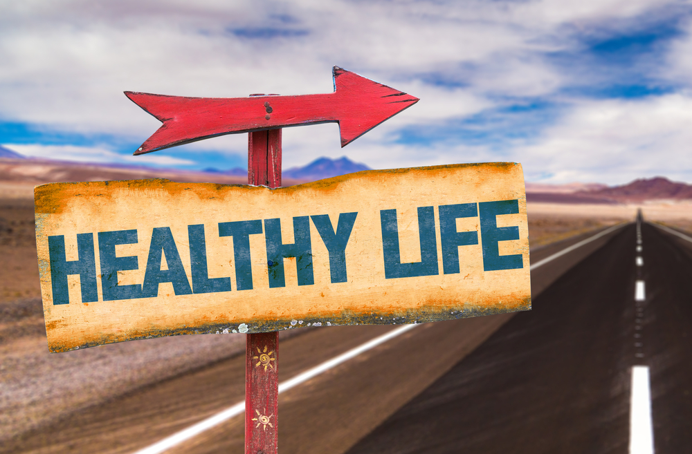 Healthy Life sign with road background: How to Keep Your Office Healthy