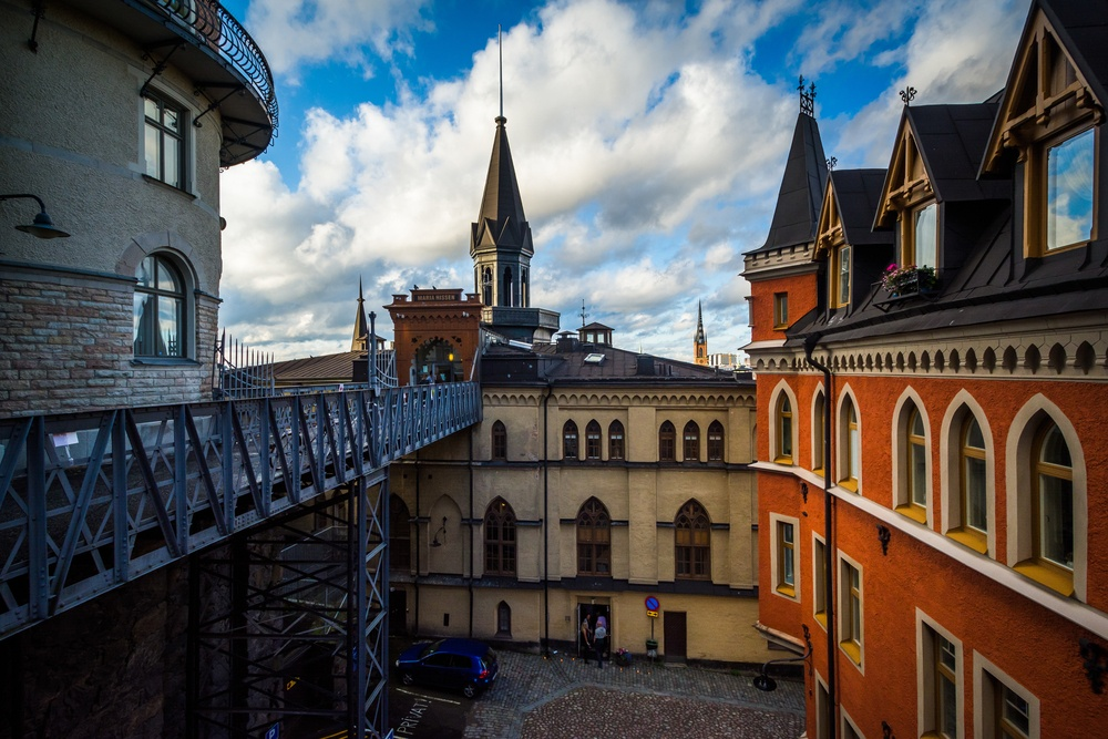 View of buildings along Bellmansgatan from an elevated walkway in Sweden.  Pushing through your  Transfer's Visa