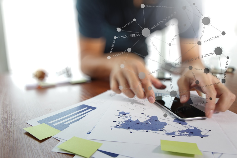 business documents on office table with smart phone : 11 important trends we see in global HR