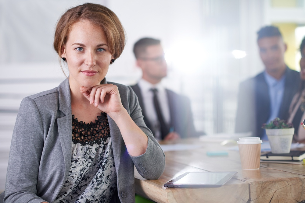 Business woman facing camera: 3 Tips for HR  Success