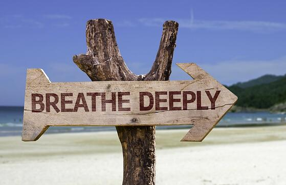 Breathe Deeply wooden sign with a beach on background.jpeg