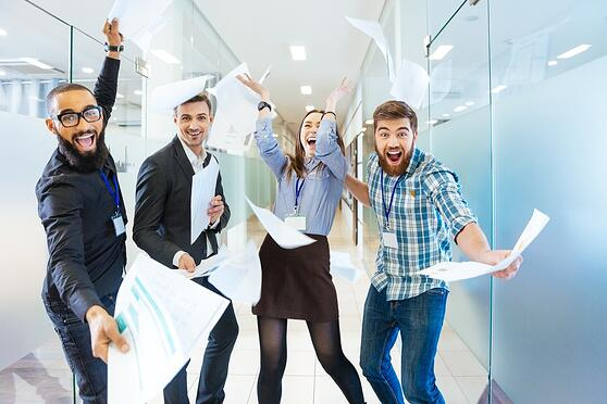 Group of joyful excited business people: What to do about expat happiness at the office