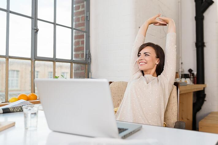 Happy relaxed young woman sitting  at computer: Do these 3 things for success